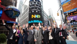 NXP executives in front of NASDAQ sign